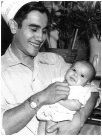 Henry Ford (Enrique Villalpando) holding his son Mike Ford, taken at Ford's restaurant, Canyonville, Oregon in 1945